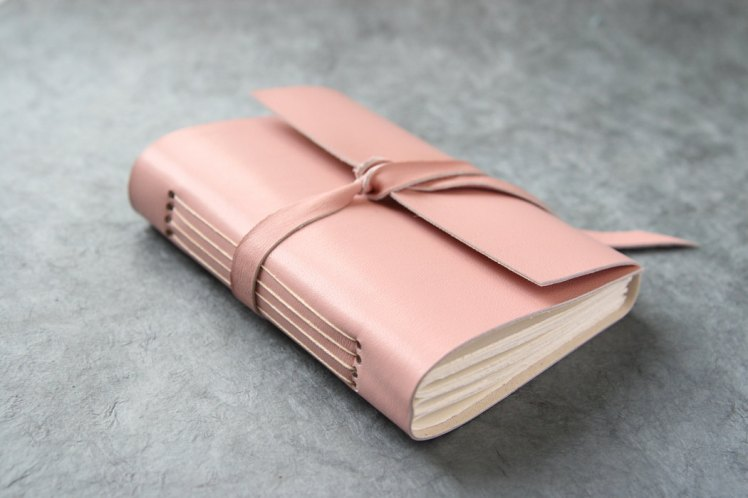 http://www.etsy.com/listing/87612646/leather-journal-pink